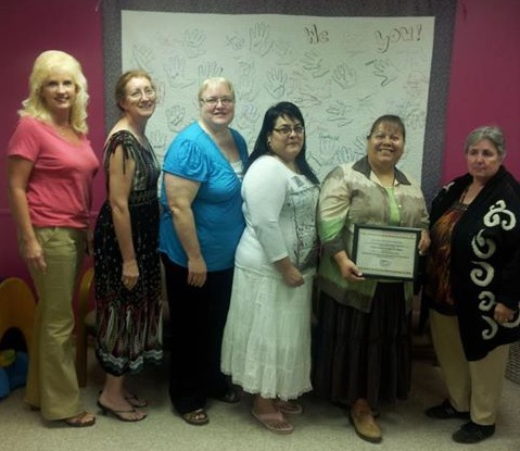 Leadership Team at Garden City Families Together, holding their K-CEATS certificate